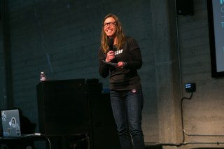 MC'ing at SupConf San Francisco. Photo courtesy of Lance Conzett